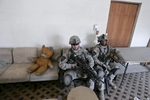 u.s. army soldiers from blackhawk company, 1st battalion, 23rd infantry regiment, take a break in a house after a foot patrol, baghdad, iraq, 2007.