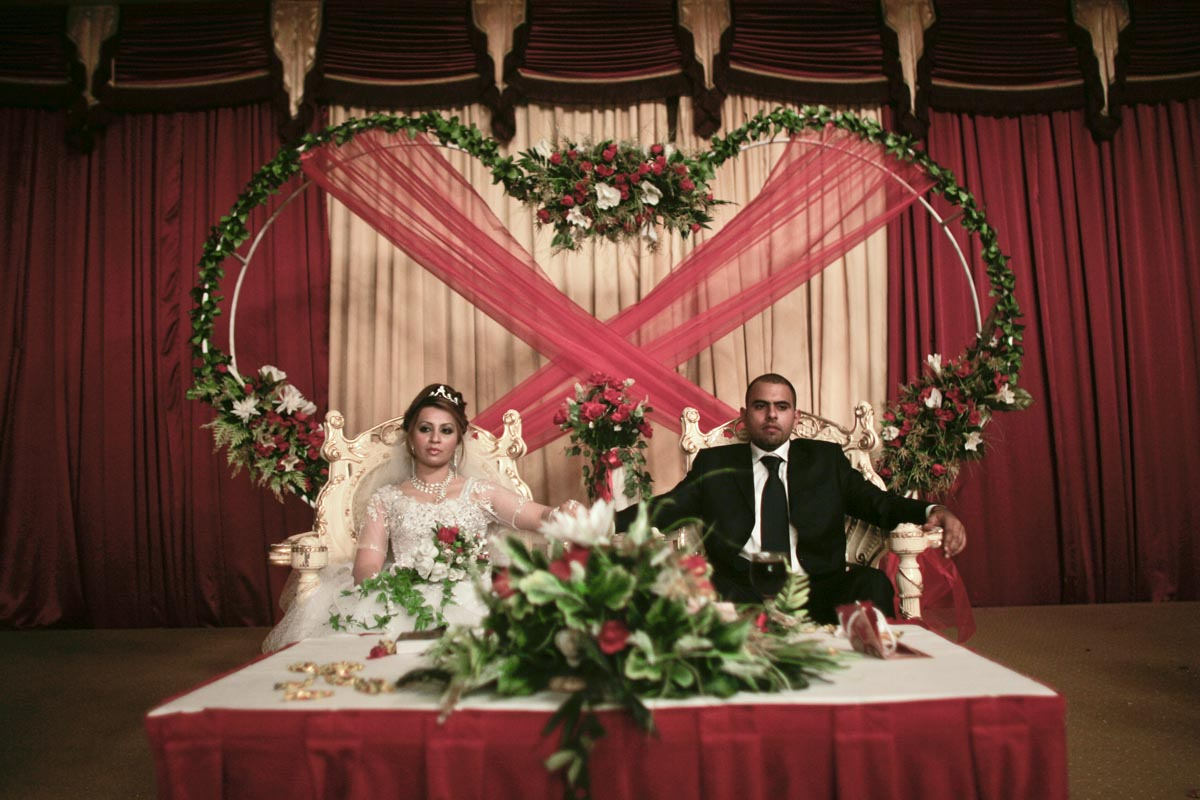 A couple pause during their wedding ceremony, Baghdad, Iraq, 2009.