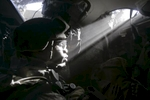 a ray of light hits the face of a u.s. army soldier from blackfoot company, 2nd battalion, 23rd infantry regiment, as he sits in a stryker armored vehicle, diyala province, 2007.