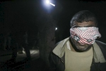 a blindfolded man is held at gunpoint by u.s. army soldiers from blackfoot company, 2nd battalion, 23rd infantry regiment, while they conduct a night raid, diyala province, iraq, 2007.