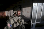a u.s. army soldier from blackhawk company, 1st battalion, 23rd infantry regiment, exits a house that his platoon had finished searching, baghdad, iraq, 2007.