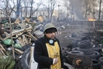 a priest mans a barricade, kiev, ukraine, feb. 21, 2014.
