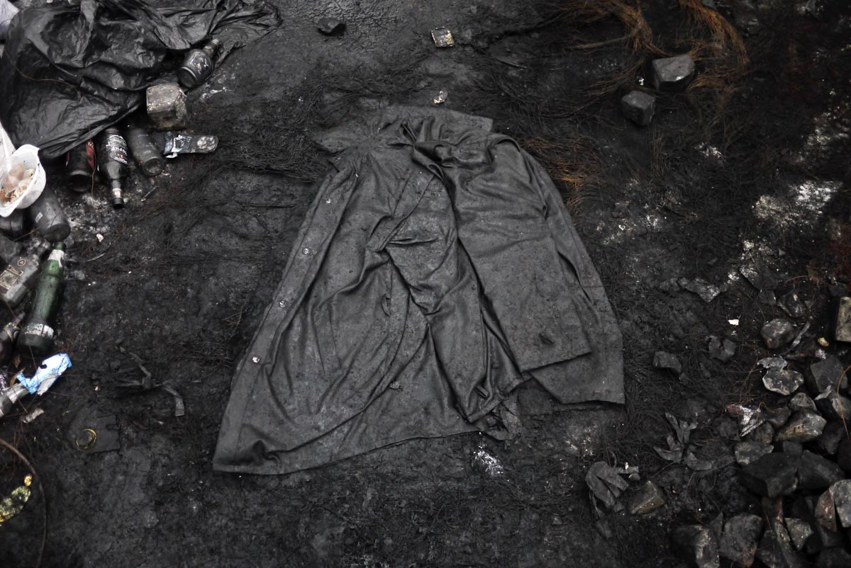 a discarded jacket lays on a street, kiev, ukraine, feb. 8, 2014.