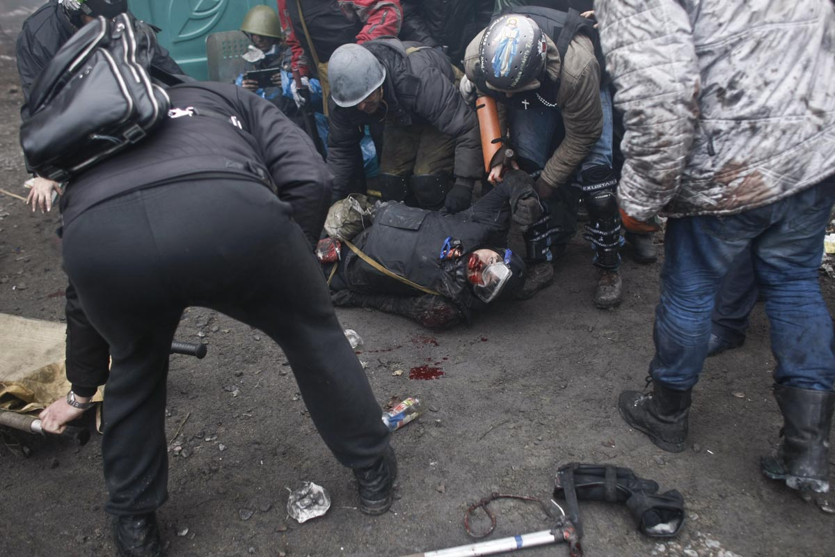 a protester is killed by a sniper, kiev, ukraine, feb. 20, 2014.