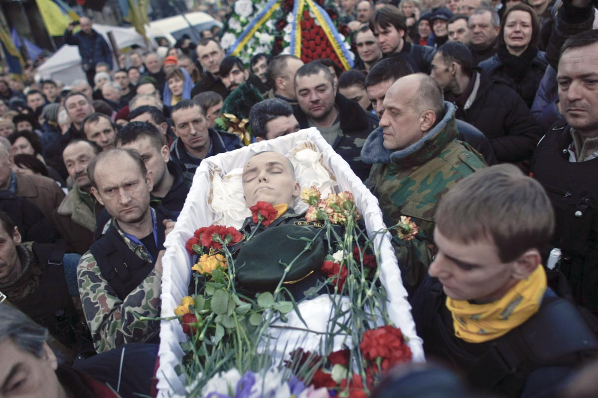 people carry a coffin of a man killed in clashes at maidan, kiev, ukraine, feb. 21, 2014.