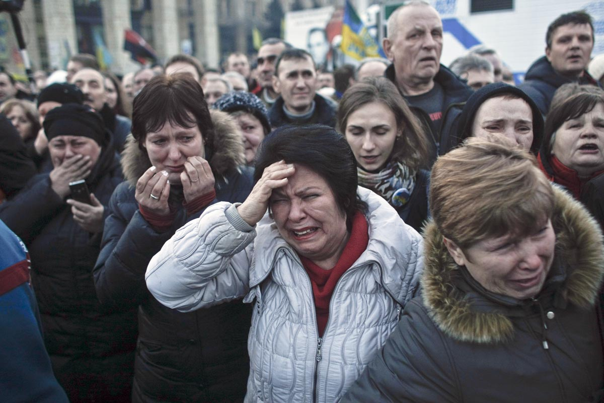 people grieve during a funeral procession, kiev, ukraine, feb. 21, 2014.
