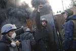 protesters chant slogans as they man a barricade, kiev, ukraine, feb. 21, 2014.