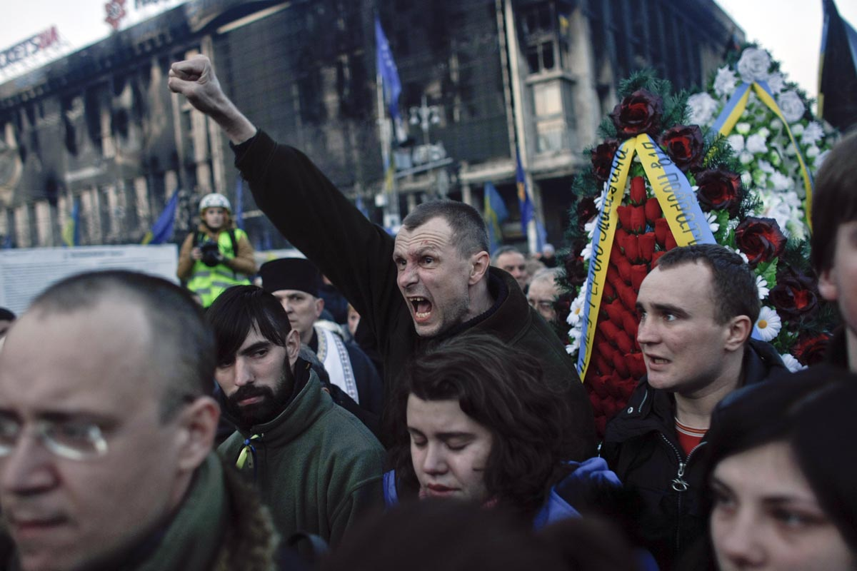 a man shouts during a solemn wake for a protester killed at maidan, kiev, ukraine, feb. 21, 2014.
