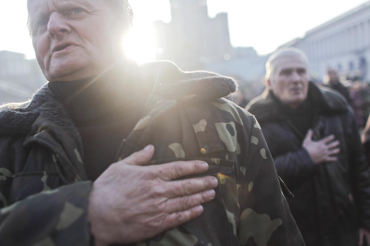 people sing the national anthem, kiev, ukraine, feb. 24, 2014.