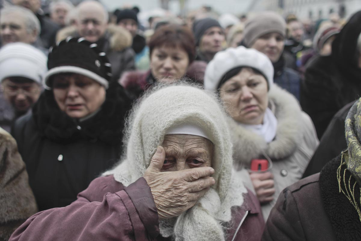 a woman mourns at a funeral procession, kiev, ukraine, feb. 25, 2014.