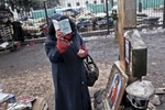a woman prays outside the parliament biuilding, kiev, ukraine, feb. 22, 2014.