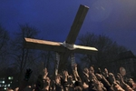 people hold a cross during a religious procession, kiev, ukraine, feb. 24, 2014.