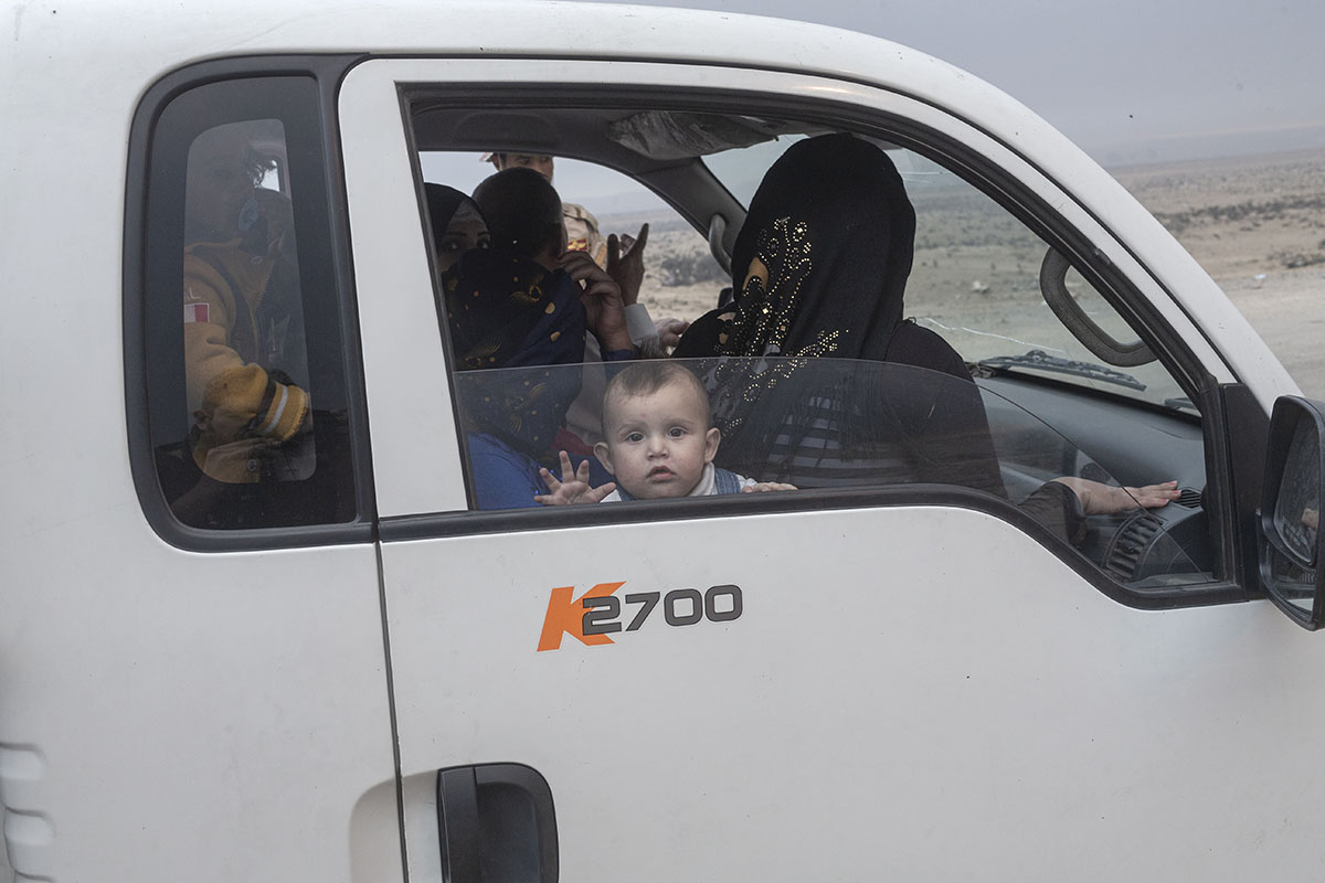 A family trying to flee from conflict is stopped at a checkpoint, Qayara, south of Mosul, Iraq, Oct. 23, 2016.