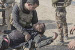 An Iraqi army solidier is consoled by a colleague after being wounded, Gogjali, outskirts of Mosul, Iraq, Nov. 6, 2016.
