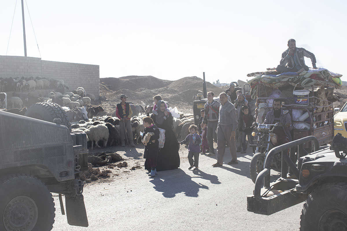 People flee the suburbs of Mosul, Gogjali, outskirts of Mosul, Iraq, Nov. 3, 2016.