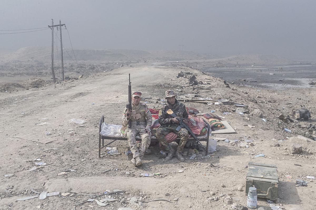 Two Iraqi army soldiers man a checkpoint, Qayara, south of Mosul, Iraq, Oct. 26, 2016.