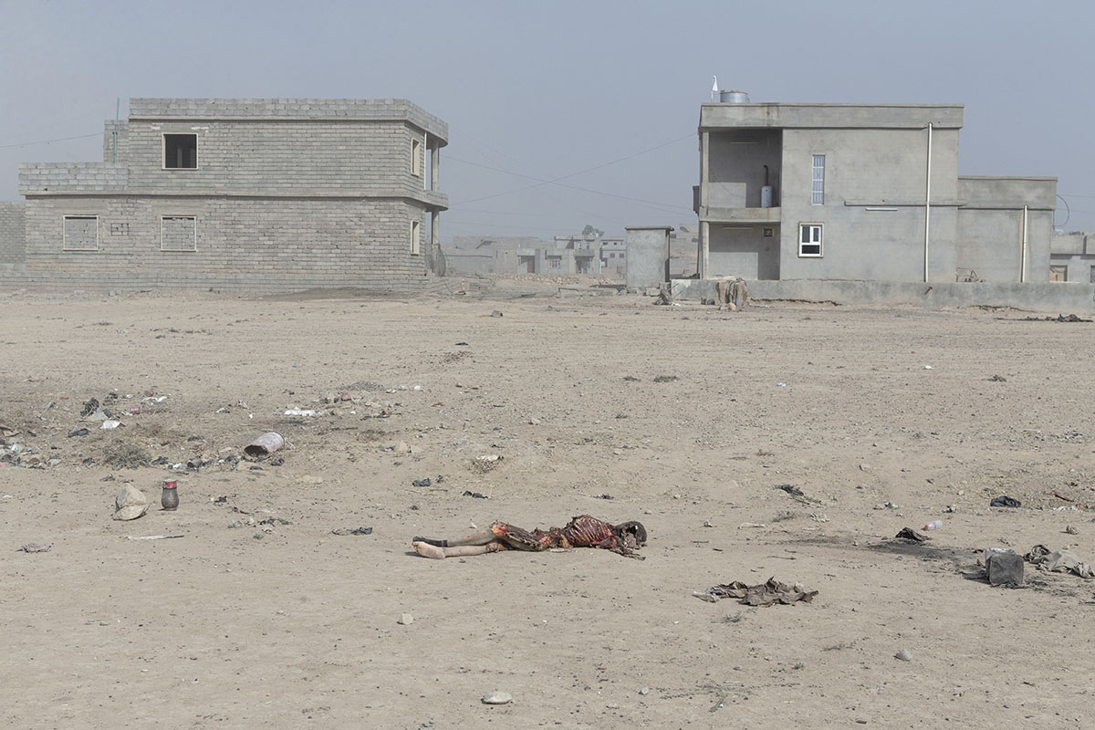 Remains of an IS militant lay on the ground, Qayara, south of Mosul, Iraq, Oct. 19, 2016.