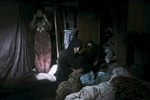 two women and a child are awoken by u.s. army soldiers from blackfoot company, 2nd battalion, 23rd infantry regiment, as they search their house during a night raid, diyala province, iraq, 2007.