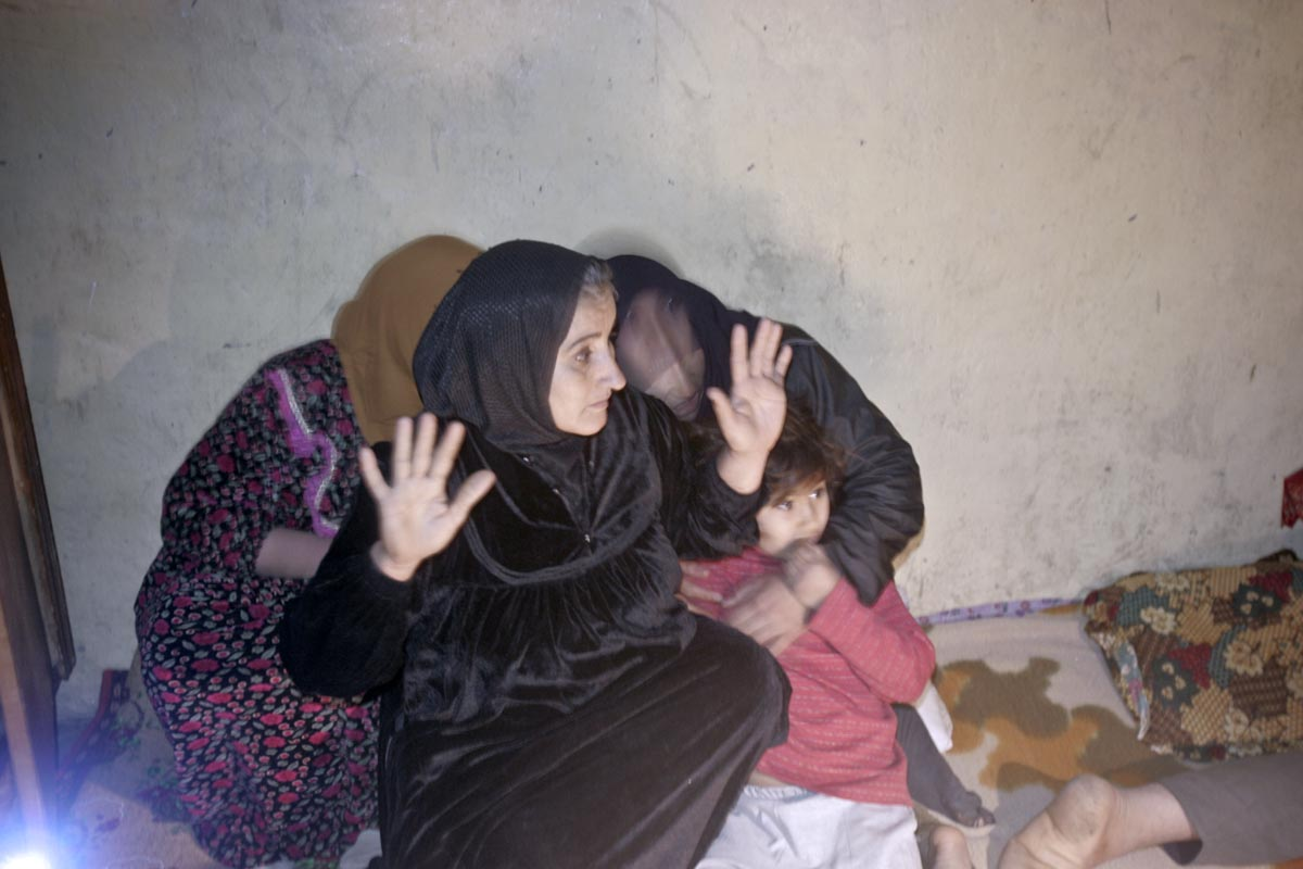 women are startled as their family member is detained by u.s. army soldiers from blackfoot company, 2nd battalion, 23rd infantry regiment, during a night raid, diyala province, iraq, 2007.