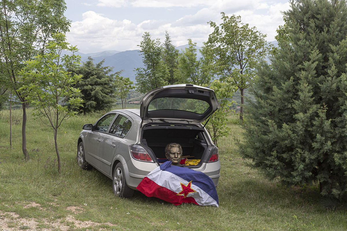A bust depicting Josip Broz Tito, former Yugoslav leader, along with the Yugoslav flag, sits inside a boot of a car, Kocani, Macedonia, May 25, 2019. The items were used in a privately organized celebration of Tito's birthday in Kocani, eastern Macedonia.