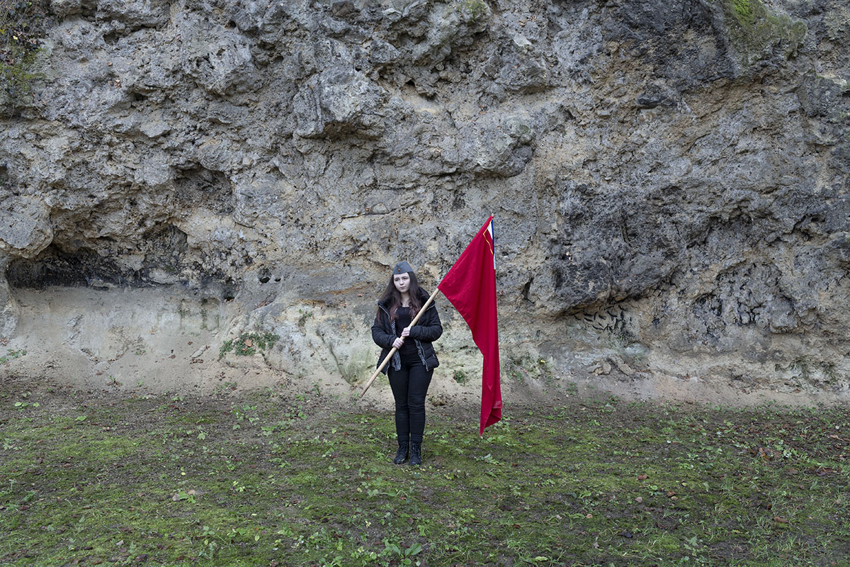 Aldijana Spahic, 14, a Yugoslav, holds a Yugoslav era flag of the Socialist Republic of Bosnia and Herzegovina, Jajce, Bosnia and Herzegovina, Nov. 25, 2017. Spahic, a student, feels Yugoslav, even though she was born after the breakup of the country and has technically never been a citizen of Yugoslavia.