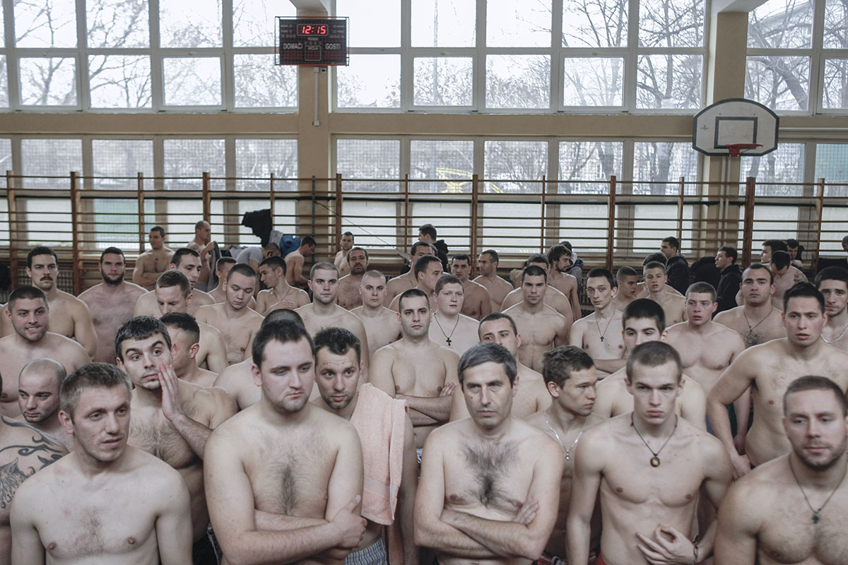 Participants in the Epiphany cross retrieval swimming race listen to a fiery motivational speech as they prepare to swim the winter waters of the Danube, Belgrade, Serbia, Jan. 19, 2014. Cross retrieval races and other Orthodox Christian religious traditions regained popularity in Serbia as nationalist and religious feelings surged after the breakup of Yugoslavia.
