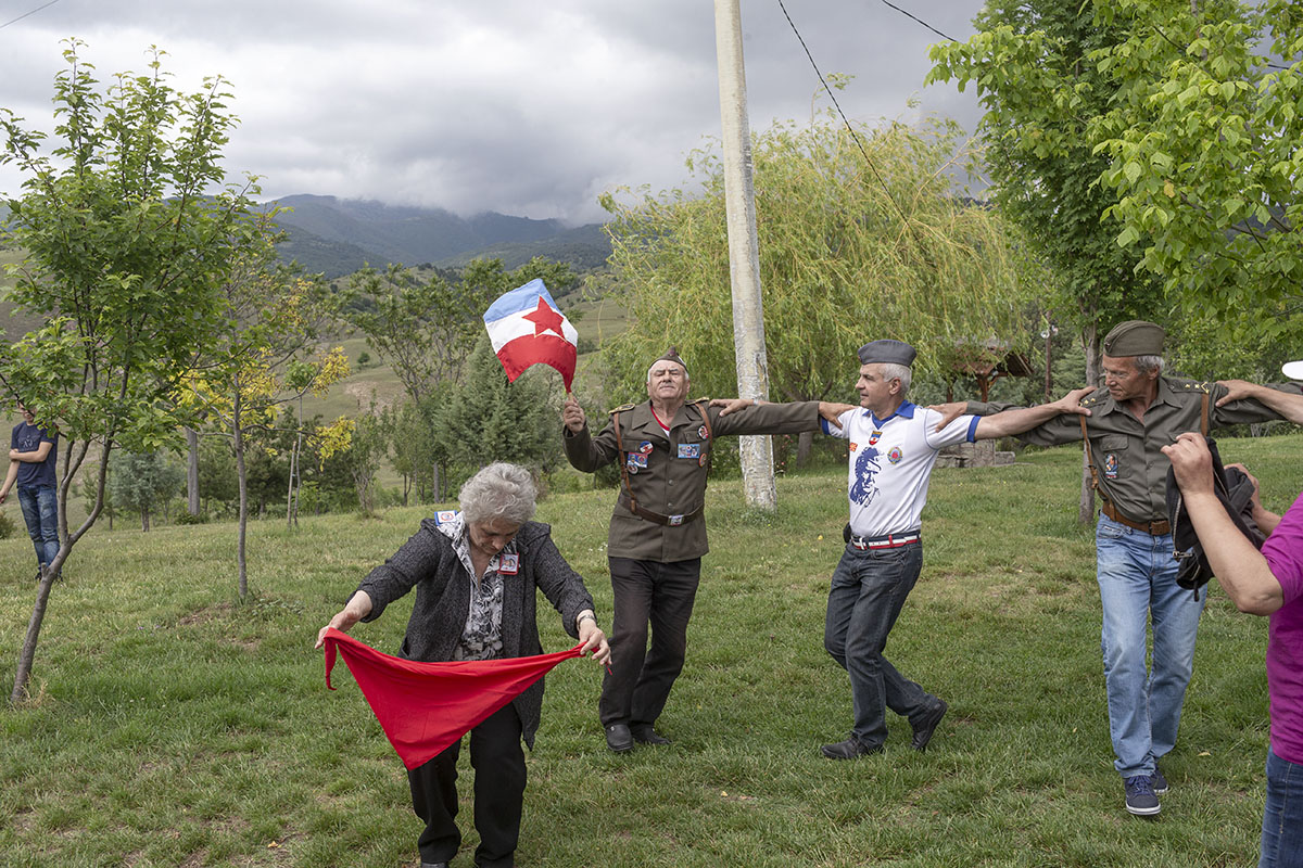 Zivorad Dimitrov, 65, a Yugoslav, leads the traditional folk dance as he carries a Yugoslav flag, Kocani, Macedonia, May 25, 2017. A small group of Yugoslavs organize a private ceremony to commemorate the birthday of Josip Broz Tito, former Yugoslav leader, each May 25th, in the Macedonian town of Kocani.