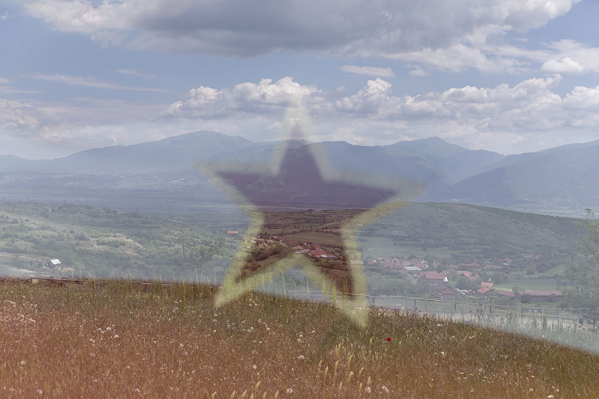 The Yugoslav flag is reflected in the windshield of a car, outskirts of Kocani, North Macedonia, May 25, 2019. A group of enthusiasts and Yugoslavs from eastern North Macedonia organizes a private celebration of Tito's birthday in the town of Kocani each May 25th.