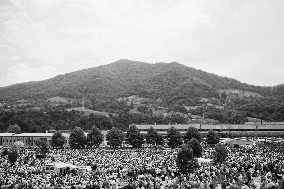 people crowd the potocari memorial center for the srebrenica victims, bosnia, 2011.
