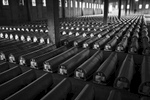 coffins containing remains of the srebrenica massacre victims lay on display, potocari memorial center, bosnia, 2010.