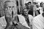 people react and pray as they wait for the remains of their relatives, victims of the srebrenica massacre, to arrive at the potocari memorial center, bosnia, 2011.