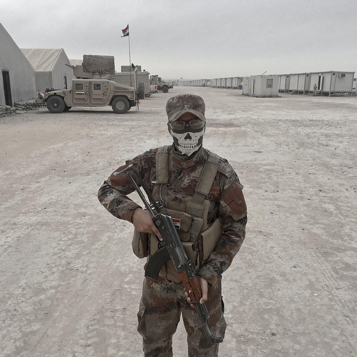 Loay Mahdi, an army soldier from Kirkuk, Iraq, stands guard at the Qayara West Coalition base in Qayara, south of Mosul, Iraq, Oct. 28, 2016.