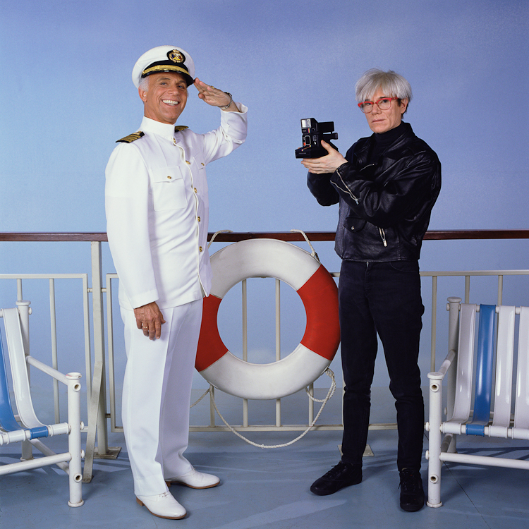 Gavin MacLeod & Andy Warhol photographed during an episode of the Love Boat, for Time inc. at the Warner's Hollywood Studio.
