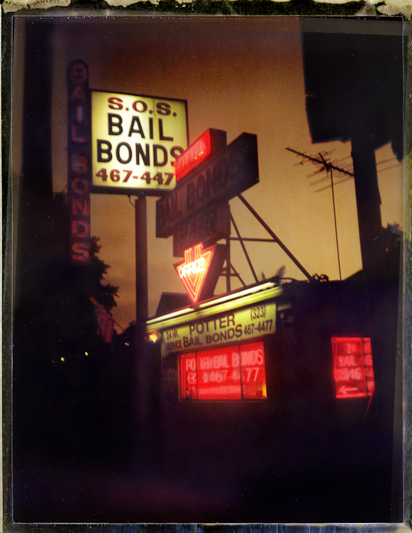 The noir 1940s / 50s {quote}SOS Bail Bonds{quote} is located across the street from the Hollywood precint police station. If buildings could  speak, SOS history is filled with hard boiled stories; one tale, the actor Robert Mitchem posted bail here in the mid 1950s on marijuana charges. Polaroid 4x5 film - Speed-Graphic camera - Archival Pigment Print40{quote} x 30{quote} Edition of 10 • 24{quote} x 20{quote} Edition of 25