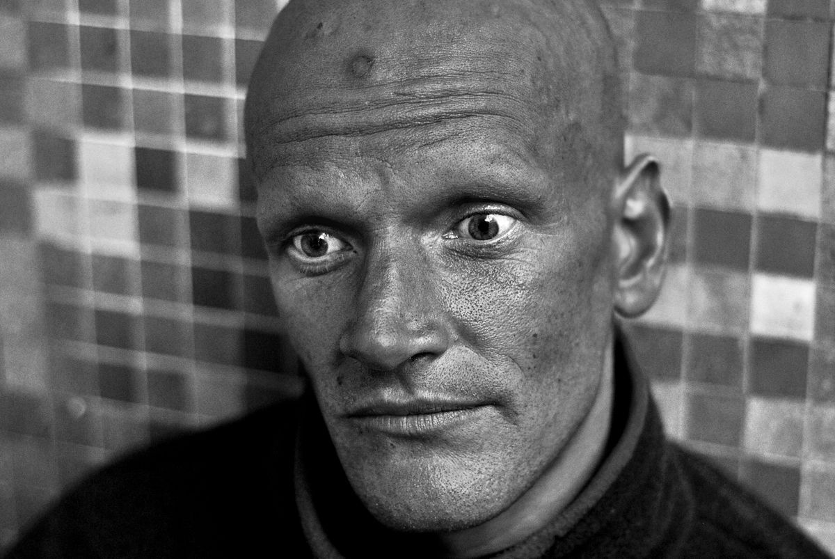 MAN FROM SHELTER IN DARK CORNER, SAN FRANCISCO, DECEMBER 2006he sits in a dark corner; barely off the sidewalk. there's vomit between us. it's mostly mucus. he seems pulled down. he's splayed out on the pavement; sitting vertical only because of the wall. but his eyes leap out.his name is chris. he's from sacramento. he's been here a few weeks. he's living in a shelter.says he's been around. done some traveling. done it all on foot though.{quote}a lot of walking{quote} i say.yes, {quote}but i didn't intend it that way.{quote} that's just how it ended up.