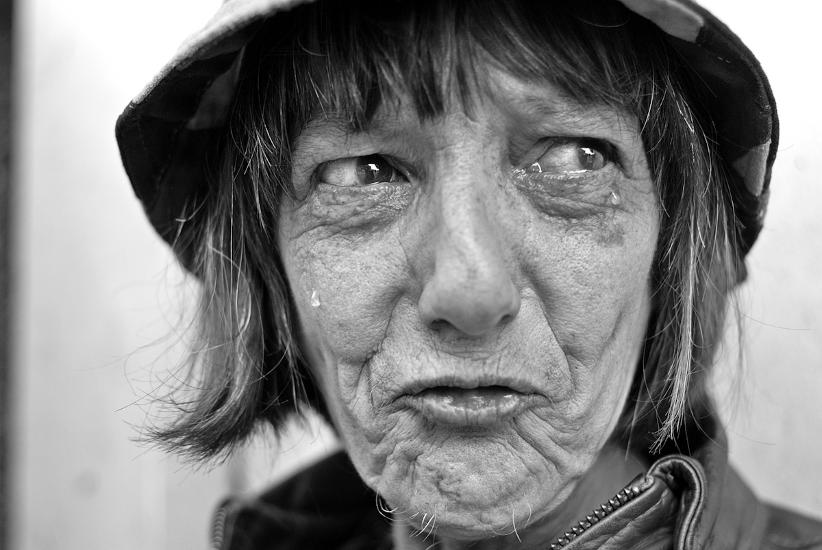 WOMAN PANHANDLING, SAN FRANCISCO, FEBRUARY 2008there's an anger in her that simmers and bursts. but the grief flows unstopped. her name is patricia. the cat in her lap is {quote}fluffy.{quote}she sits erect unbent but her face betrays every thought.she has cancer in her stomach.{quote}i'm not afraid to show you{quote} she offers as she shows her withered belly.her husband died in '03 with the life she had. this one is hard to bear. they prey on her because she doesn't fight back. she can't; she won't. they come into her room at the hotel and take everything. every month, they take everything.and for what she needs, they want her to do things.{quote}but i'm 56{quote} i can't do those things.she cries and she yells and she spits spiteful words. these men.then she stops.{quote}i'm sorry{quote} i shouldn't.
