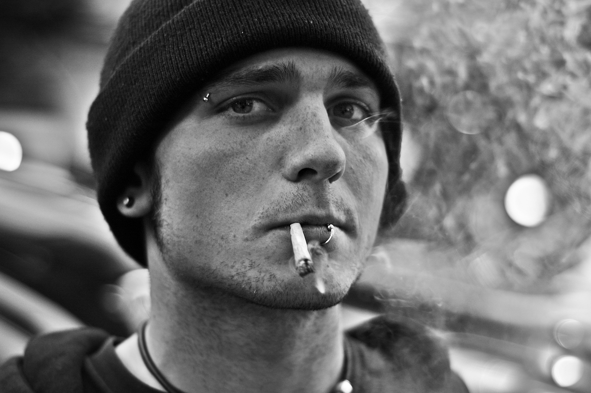 HOMELESS BOY SMOKING, SAN FRANCISCO, MARCH 2006homeless brad from illinois sitting on the sidewalk panhandling.(3/29/06)