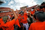 Sean Mannion (4) celebrates with Beaver Nation after OSU's upset over the Wisconsin Badgers at Reser Stadium on September 9, 2012.