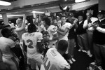 Oregon State players and coaches celebrate in the locker room after beating BYU 42-24 in Provo, Utah.