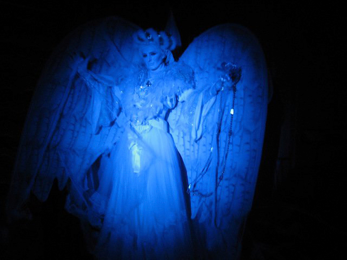 Classic White Angel under blue light