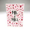 purchase heresweet + simple, this card boasts so much love for the new mr + mrs.each card:is printed on 100# recycled + responsibly-sourced paper //measures 3.5{quote} x 5{quote} //is accompanied by a recycled kraft paper 4-bar envelope //professionally printed //individually packaged in sealed cellophane sleeve //crafted + printed in colorado, usa.
