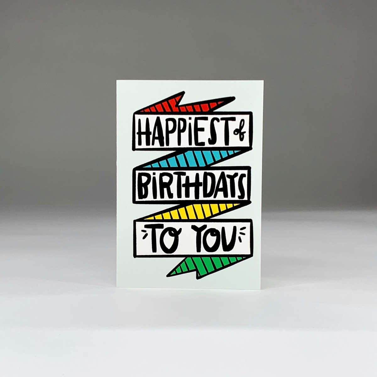 purchase herehappiest of birthdays to you... what else needs to be said?? this fun hand-drawn note card is perfect for anyoneeach card:is printed on 100# recycled + responsibly-sourced paper //measures 3.5{quote} x 5{quote} //is accompanied by a recycled kraft paper 4-bar envelope //professionally printed //individually packaged in sealed cellophane sleeve //-------------------------crafted + printed in colorado, usa.