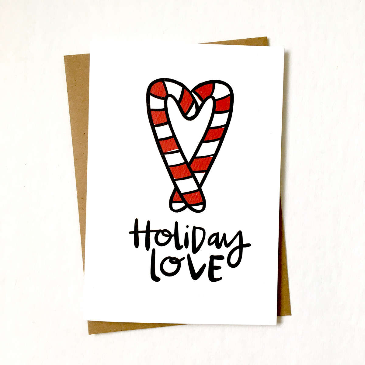 purchase herespread a little extra love around this holiday season // warm the hearts of those who makes your life a little bit sweeter with this new candy cane holiday card // snag yours now while they're still in stock!each card is:printed on 100# recycled + responsibly-sourced paper //measuring 3.5{quote} x 5{quote} //accompanied by a recycled kraft paper 4-bar envelope //professionally printed on a digital press //individually packaged in sealed cellophane sleeve //made with mad love in colorado, usa.