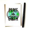 purchase herepeace on earth... seems simple enough, right?! // this brand new holiday card is the perfect little reminder of what this season is really all about // snag yours now while they're still in stock!each card is:printed on 100# recycled + responsibly-sourced paper //measuring 3.5{quote} x 5{quote} //accompanied by a recycled kraft paper 4-bar envelope //professionally printed on a digital press //individually packaged in sealed cellophane sleeve //made with mad love in colorado, usa.