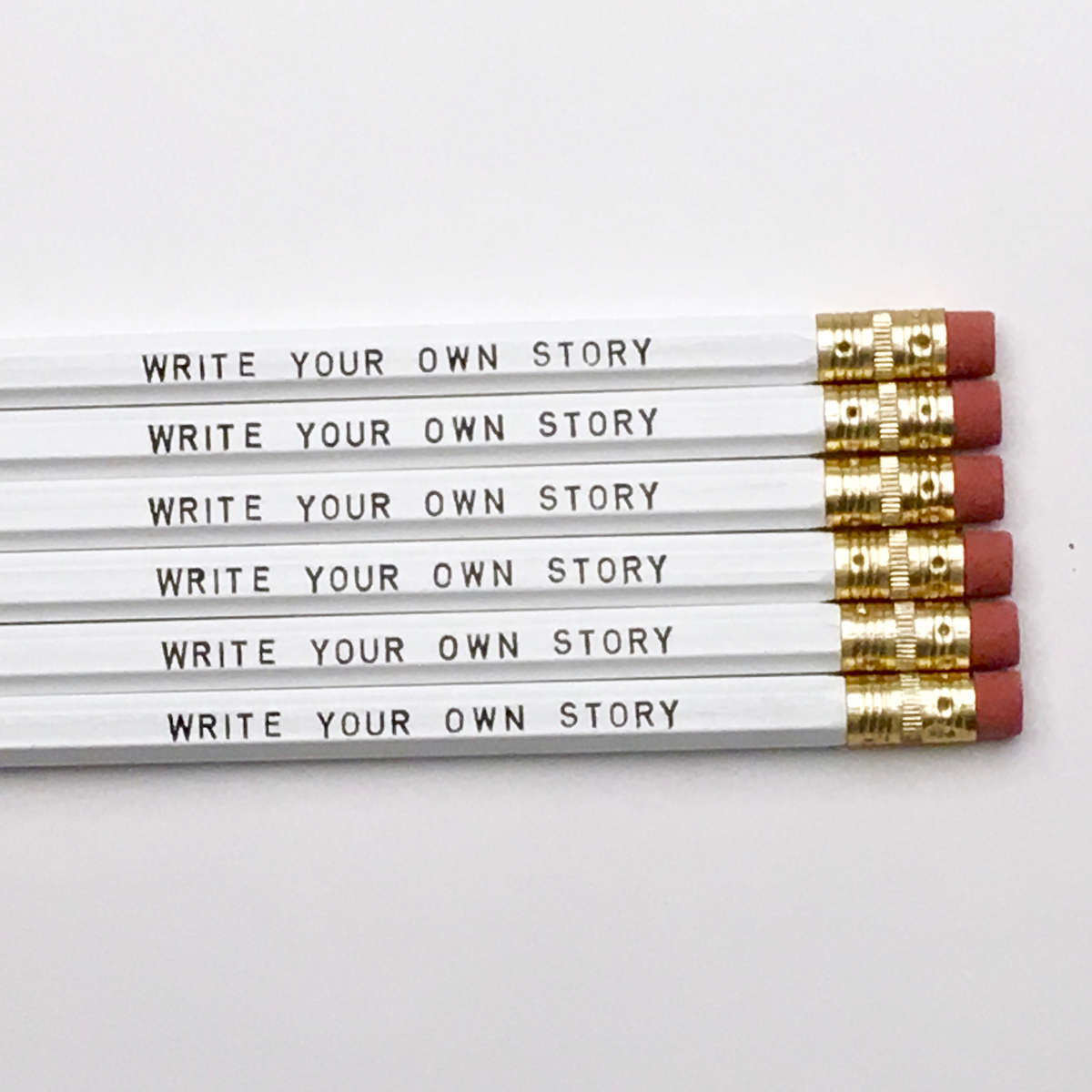 purchase herethis pencil set is perfect for any stationery lover. // whether you're a brain surgeon or an entrepreneur or a professional daydreamer,we encourage everyone to write their own story... and, by all means, make it memorable.set of six imprinted hexagon pencils // white pencils + black textunsharpened + packaged in a sealed cellophane sleeve (ready for gift giving)fantastic gift idea for teachers + students + anyone, really... especially yourself!