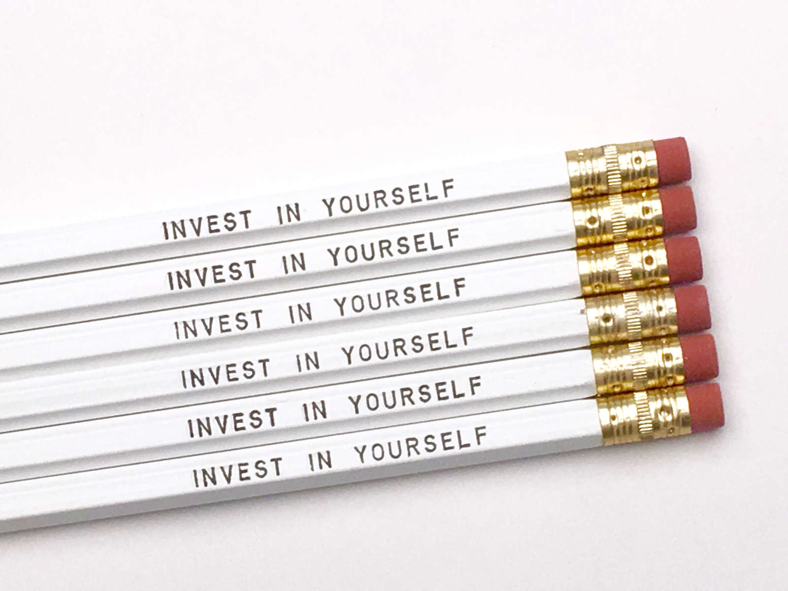purchase herethis pencil set is perfect for any stationery lover. // if you ever want to be better than you are right this very minute, you must choose to invest in yourself. // whether it's investing time or money or priority... it all adds up. // you, my friend, are worth it, every single time!set of six imprinted hexagon pencils // white pencils + black textunsharpened + packaged in a sealed cellophane sleeve (ready for gift giving)fantastic gift idea for teachers + students + anyone, really... especially yourself!