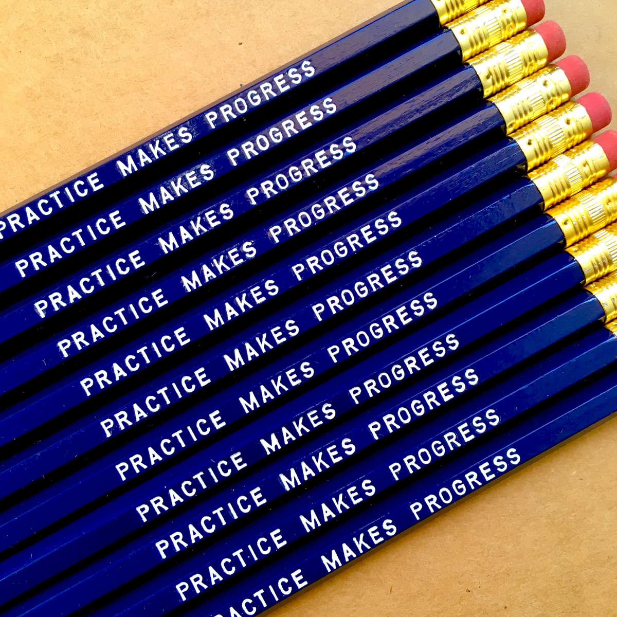 purchase herepractice makes progress... strive for growth, not perfection.set of six imprinted hexagon pencils // blue pencils + white textunsharpened + packaged in a sealed cellophane sleeve (ready for gift giving)fantastic gift idea for teachers + students + anyone, really... especially yourself!