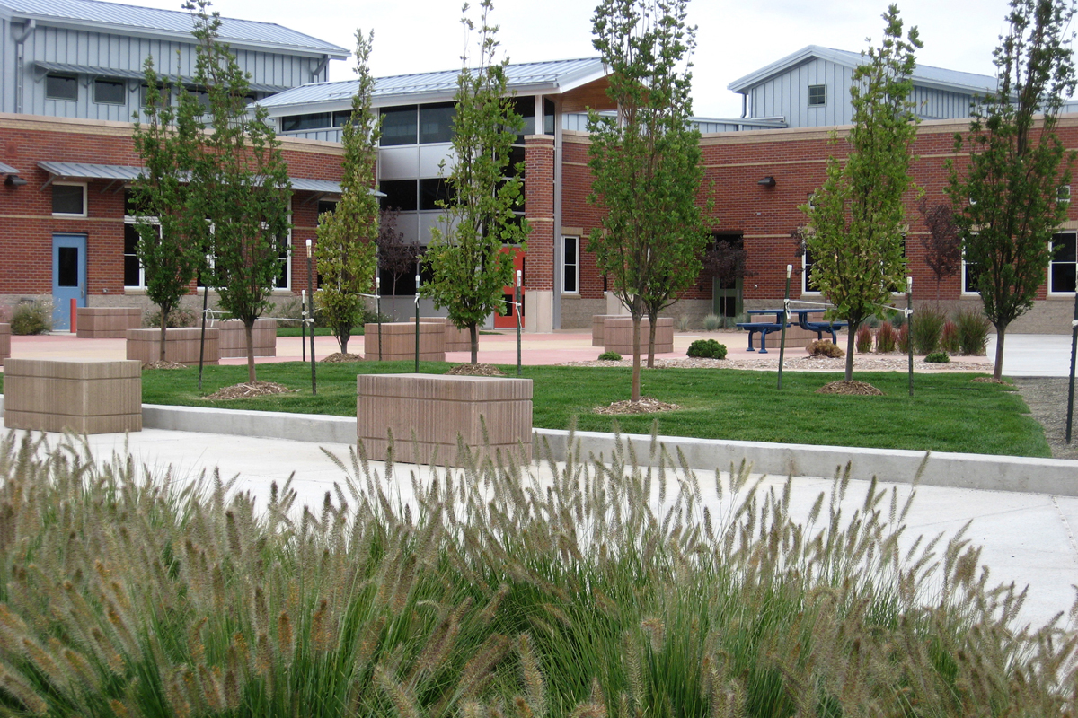 landscape, ornamental grasses, hay bale benches, entry plaza, orchard