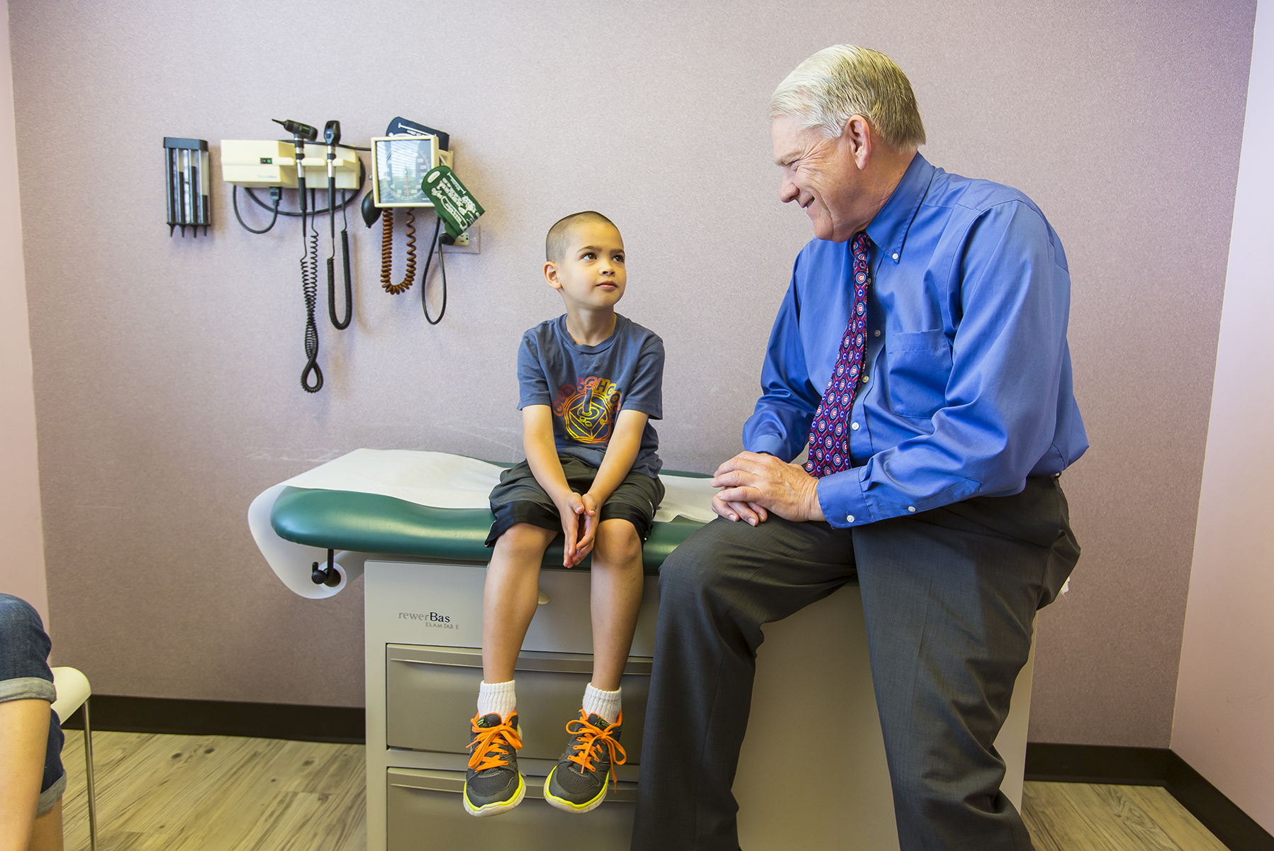 Dr. Timothy Wall performs a regular yearly checkup on Logan Bremner at his Naperville offices  on May 25, 2016.  Manuel Martinez/ Crains Chicago Business