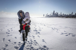 Chicago residents visit the Lakefront of Lake Michigan during the polar vortex on Jan, 30, 2019. Wednesday marks the coldest day in Chicago history. From the crackling Lakefront to the city's El stops, locals took on the record breaking wind chills. The polar vortex that brought the Chicago area to a halt in January will now be remembered as producing the state's coldest temperature ever, according to weather officials. Manuel Martinez/WBEZ
